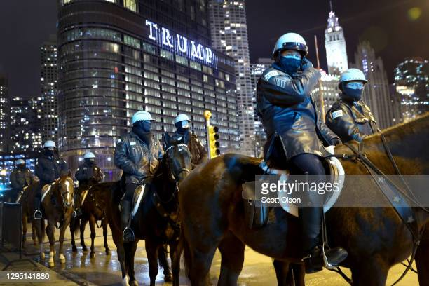 Police keep watch as a small group of demonstrators protest near Trump Tower on January 07, 2021 in Chicago, Illinois. Protesterdscalled for the...