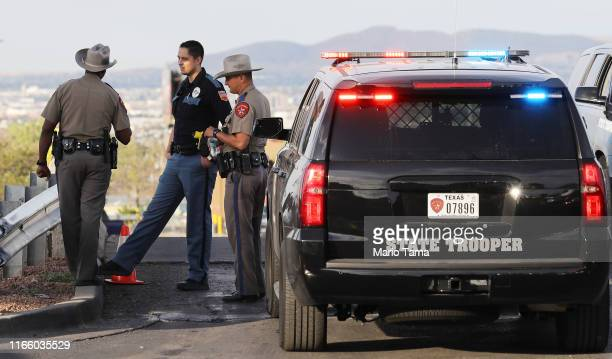 Police keep watch outside a Walmart near the scene of a mass shooting which left at least 20 people dead on August 4 2019 in El Paso Texas A...