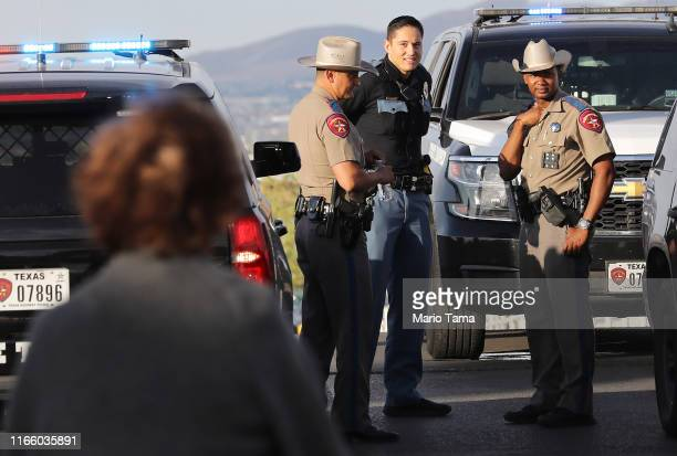 Police keep watch outside a Walmart near the scene of a mass shooting which left at least 20 people dead on August 4, 2019 in El Paso, Texas. A...