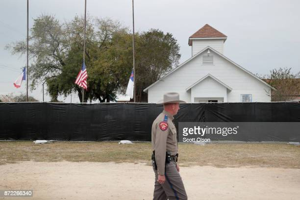 Police keep watch outside of the First Baptist Church of Sutherland Springs after it was surrounded by a tarp on November 9 2017 in Sutherland...