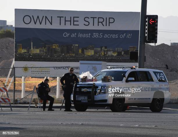 Police keep watch outside the Route 91 music festival site beside the Mandalay Hotel October 4 2017 on the Las Vegas Strip after a gunman killed 58...
