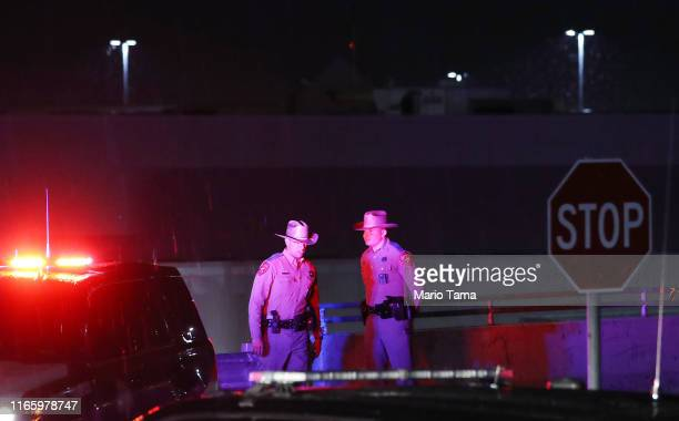 Police keep watch outside Walmart near the scene of a mass shooting which left at least 20 people dead on August 3 2019 in El Paso Texas A 21yearold...