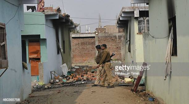 Police keeping vigil in a deserted street Aman colony at Karond area on December 12 2014 in Bhopal India Two sects of a religious community clashed...