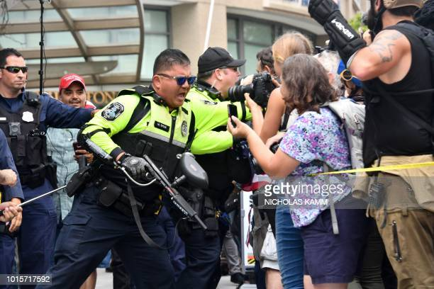 Police keeps farright demonstrators and counterprotestors apart during a rally at Lafayette Park opposite the White House August 12 2018 in...