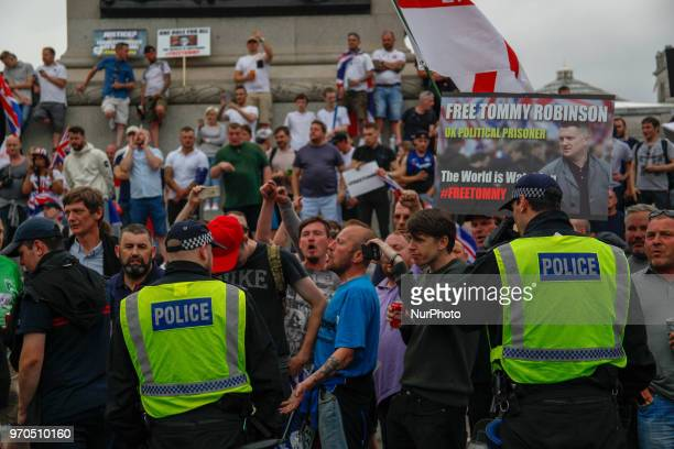 Police Kettle supporters of Tommy Robinson at Trafalgar Square during a 'Free Tommy Robinson' protest on Whitehall on June 9 2018 in London England...