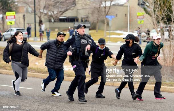 March 22:Police, King Soopers employees and customers run down Table Mesa Drive in Boulder after reports of shots fired inside on Monday, March 22,...