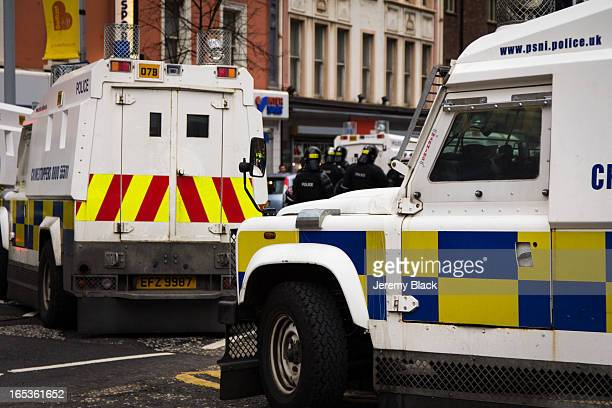Police Land Rovers move into Chichester Street during a protest by loyalists at City Hall in Belfast, Northern Ireland on January 5, 2013. The...