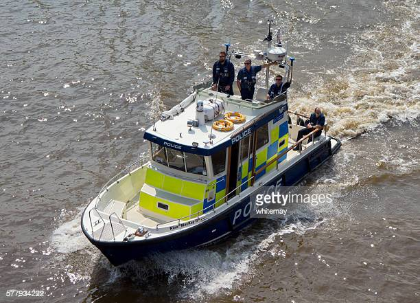 Police launch travelling down the River Thames