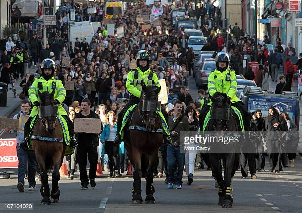 Police lead a demonstration over tuition fees and university funding on November 24 2010 in London United Kingdom This is the second student day of...