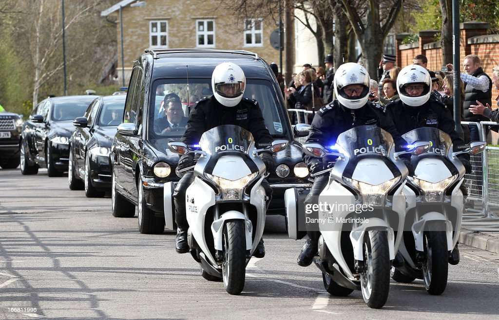 Police lead former British Prime Minister Baroness Thatcher's coffin as it arrives in the hearse at Mortlake Crematorium where her private cremation will take place on April 17, 2013 in London, England. Dignitaries from around the world today join Queen Elizabeth II and Prince Philip, Duke of Edinburgh as the United Kingdom pays tribute to former Prime Minister Baroness Thatcher during a Ceremonial funeral with military honours at St Paul's Cathedral. Lady Thatcher, who died last week, was the first British female Prime Minister and served from 1979 to 1990.