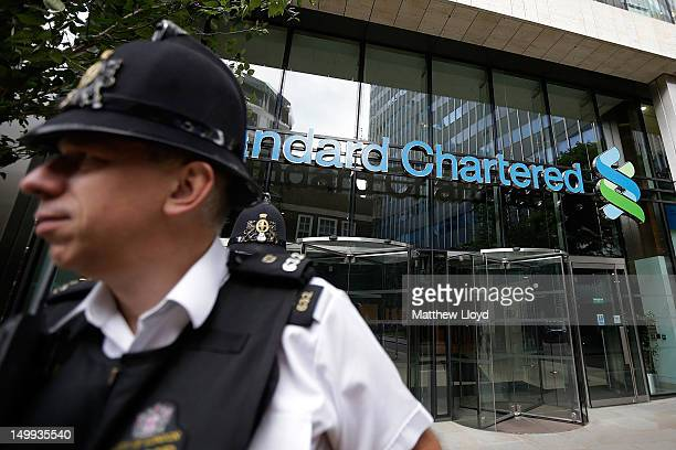 Police leave the Standard Chartered bank's offices after visiting on August 7 2012 in London England Standard and Chartered has been accused by...