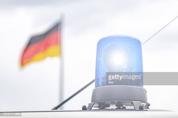 police light with german flag - germany stock pictures, royalty-free photos & images