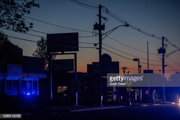 Police lights illuminate Winthrop St after the power was cut to the entire city of Lawrence and other surrounding communities becuase of an outbreak...