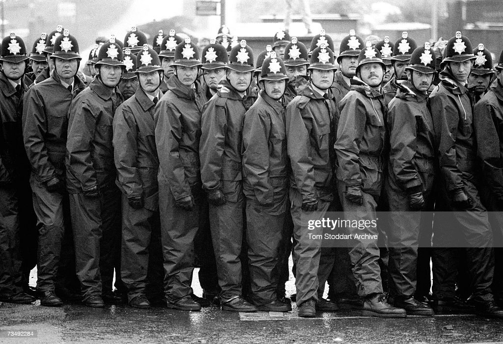 A police line during a confrontation with miners at the Orgreave coking plant in South Yorkshire, 18th June 1984. The most violent incident of the UK miners' strike of 1984-1985, the 'Battle Of Orgreave' involved a mass picket by the National Union of Mineworkers (NUM) and police from 10 counties.