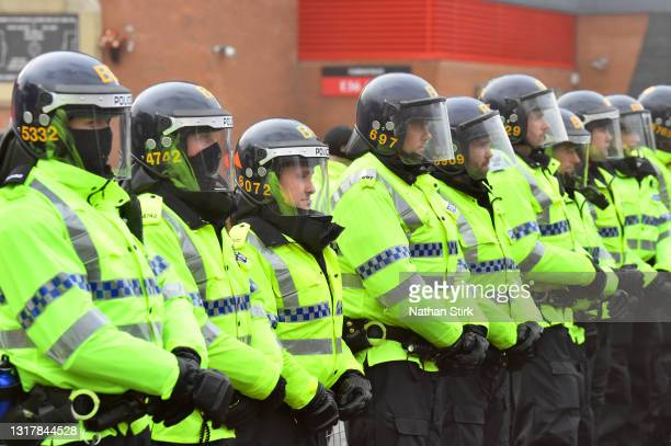 Police line is seen as fans protest at Old Trafford on May 13, 2021 in Manchester, England. Police and ground security staff are prepared for a...
