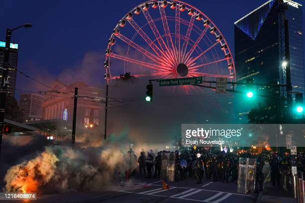 A police line is seen during a protest in response to the police killing of George Floyd on May 30 2020 in Atlanta Georgia Across the country...