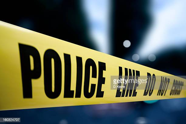 police line - cordon tape stock pictures, royalty-free photos & images