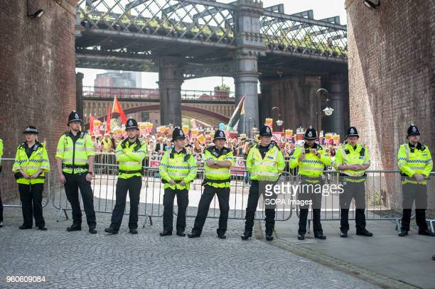 A police line separates the Unite Against Fascism protest from The Football Lads Association rally in Castlefield Arena in Manchester days before the...