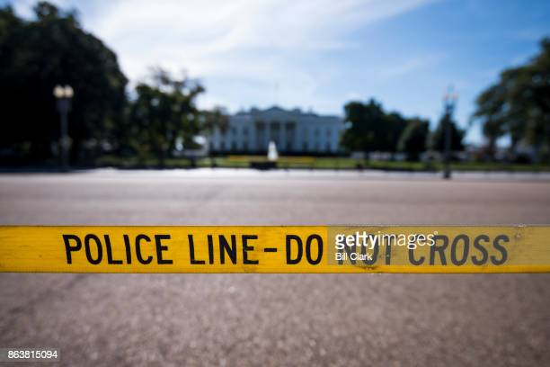 Police line tape blocks pedestrians from crossing Pennsylvania Avenue from Lafayette Square to the White House in Washington, DC on Friday, Oct. 20,...