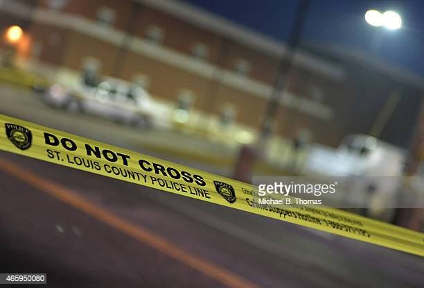 A police line tape is shown as it blocks off an area on South Florissant Road outside the Ferguson Police Department on March12 2015 in Ferguson MO...