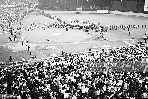 Police line the field protecting The Beatles from enthusiastic fans during a concert in Shea Stadium New York