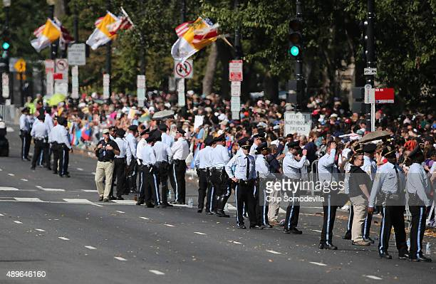Police line the route as they wait for Pope Francis for a parade around the National Mall on September 23 2015 in Washington DC Thousands of people...