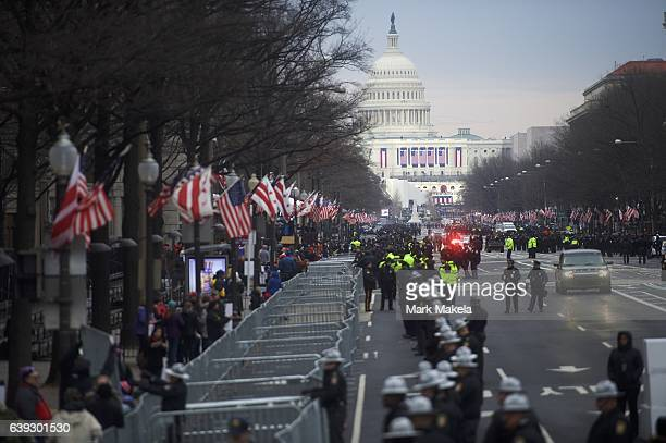 Police line the streets in front of the Trump International Hotel with the Capitol Building in the distance before the inauguration of Donald Trump...
