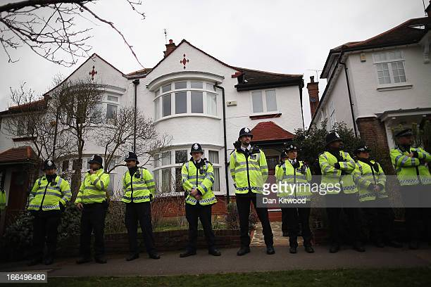 Police line up as UK UNCUT supporters protest over the government's changes to the welfare system and the proposed 'Bedroom Tax' on April 13 2013 in...