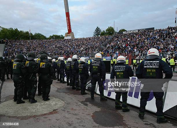 Police line up in front of the Hamburg fan block during the second leg of the Bundesliga playoff match between Karlsruher SC and Hamburger SV at...
