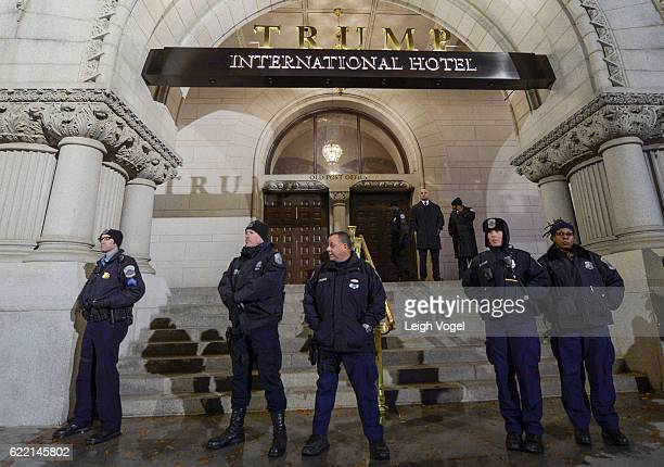 Police line up in front of the Trump International Hotel where demonstrators protest President Elect Donald Trump on November 9 2016 in Washington DC