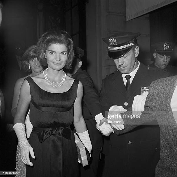 Police lock arms to hold back the curious as Jacqueline Kennedy and her sisterinlaw Mrs Peter Lawford leave the St Regis Hotel June 16th after...