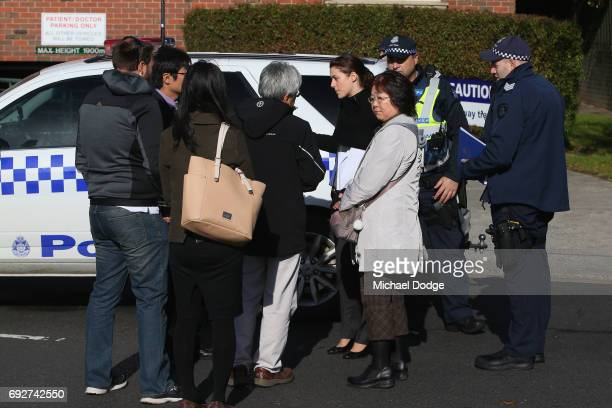 Police look after residents outside service apartments on June 6 2017 in Melbourne Australia Police are treating an incident where an armed man shot...