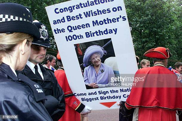 Police look on as crowd gathered outside Buckingham Palace for the arrival of The Queen Mother before she appears on the balcony of Buckingham Palace...