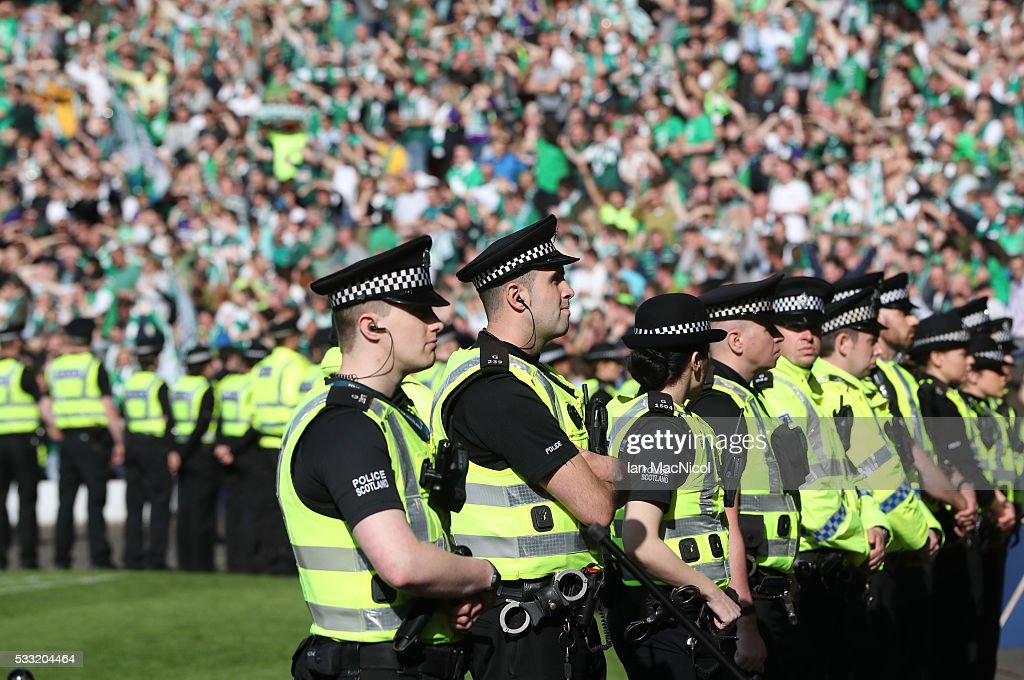 Police look on as Hibs fans celebrate during the Scottish Cup Final between Rangers and Hibernian at Hampden Park on May 21, 2016 in Glasgow, Scotland.