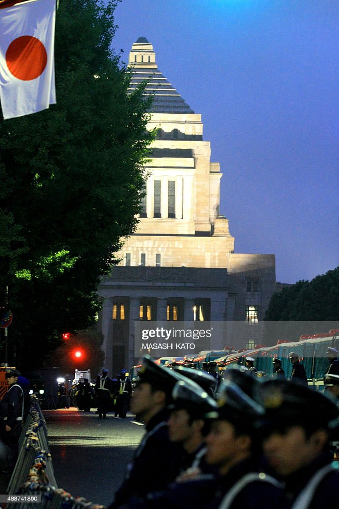 Police look on as people protest against the new Japan Security Bill on September 17, 2015 in Tokyo, Japan. Hundreds of people gathered to protest against the security bills to expand the roles of Japan Self Defense Force. The scheduled committee vote, which is the second to last vote before the law officially being passed, has been repeatedly delayed by the opposition party. The ruling coalition party lawmakers are aiming to pass the legislation before the end of week.