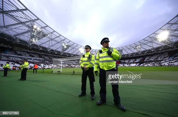 Police look on at the fans after the Premier League match between West Ham United and Burnley at London Stadium on March 10 2018 in London England