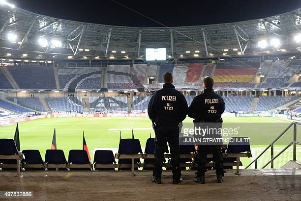 Police looks at the pitch at the HDI Arena after the friendly football match Germany vs the Netherlands was called off for 'security reasons' in...