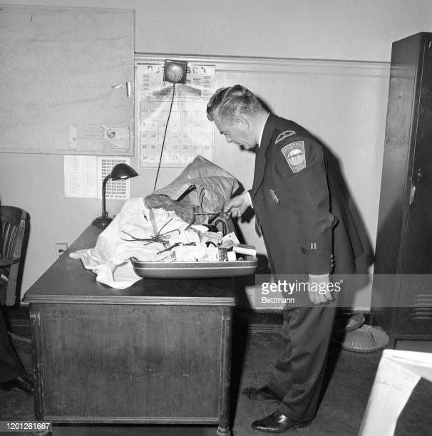 Police Lt. James J. MacDonald examines surgical tools allegedly used to perform an abortion on a 23-year-old. A Brookline, MA man who called himself...