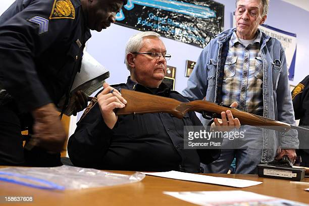 Police Lt Ray Mesek registers a rifle at a gun buyback event at the Bridgeport Police Department's Community Services Division on December 22 2012 in...