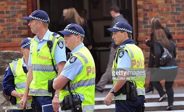 Police maintain a high presence as mourners arrive for the funeral of slain gangland killer Carl Williams, in Melbourne on April 30, 2010. Carl...