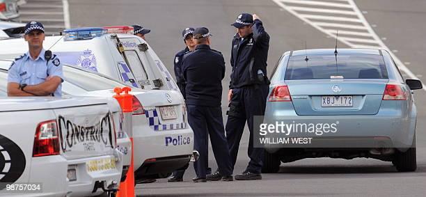 Police maintain a high presence at the funeral of slain gangland killer Carl Williams, in Melbourne on April 30, 2010. Carl Williams was bashed to...