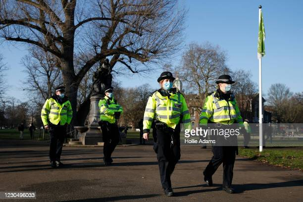 Police maintain a presence at Clapham Common during the anti-lockdown demonstration on January 9, 2021 in London, England. Chief Medical Officer...