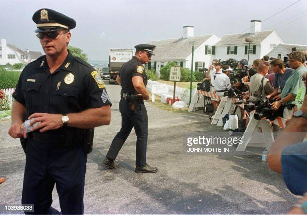 Police maintain a security zone for the press outside the Kennedy compound in Hyannisport Massachusetts where family and friends are waiting to hear...