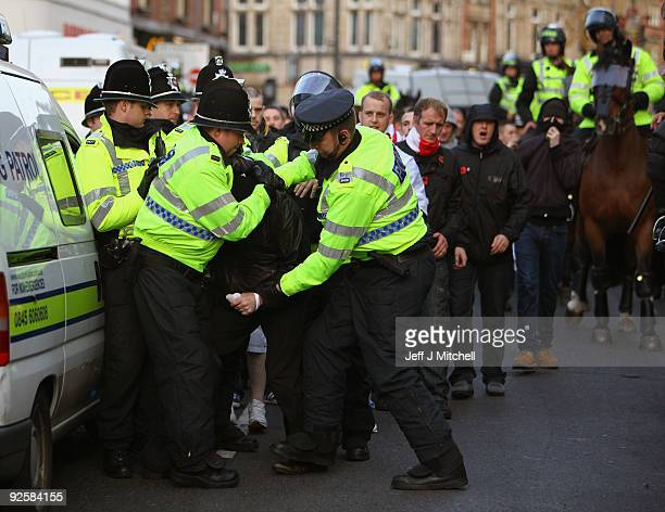 Police make an arrest as Members of the English Defence League demonstrate in Leeds town centre on October 31 2009 in Leeds England The English...