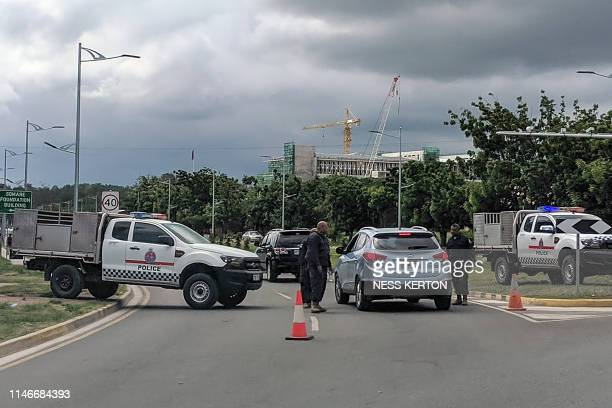 Police man a road block leading to Parliament house in Port Moresby on May 28 2019 Papua New Guinea Prime Minister Peter O'Neill stalled his...