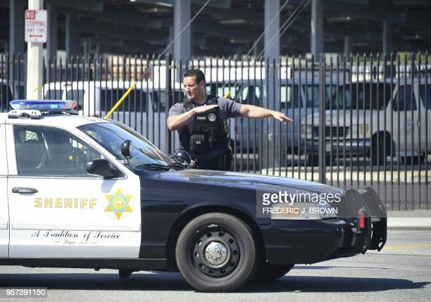 Police man an intersection May 11 2018 following reports of shooting at Highland High School in Palmdale 40 miles north of downtown Los Angeles...