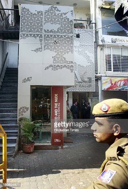 Police man outside Delhi art Gallery during an art exhibition 'The Naked and the Nude' at Delhi Art Gallery at Hauz Khas Village on February 6 2013...