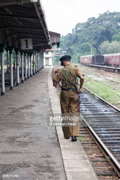 Police man patrolling along a rail track