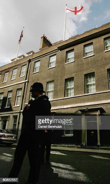 A police man stands as St George's flag is seen above 10 Downing St on April 23 2008 in London England This is the first time the St George flag has...