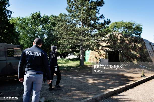 Police man supervised a migrant in the police station of the Italian border town Fernetti after been discovered cross the border between Italy and...